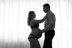 Black and white pregnant woman and her husband Stock Images
