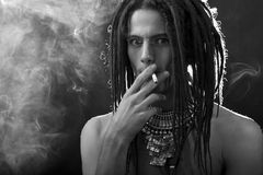 Black and white profile portrait of a young man with dreadlocks Stock Image