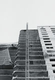 black and white Protective catching grid net belay guard tense in the construction of a multistory newly building house. Stock Photos