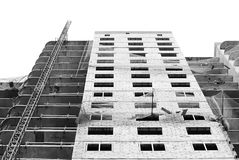 Black and white Protective catching grid net belay guard tense in the construction of a multistory newly building house. Stock Photo
