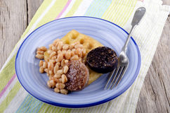 Black and white pudding with baked beans Stock Photography