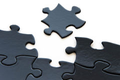 Black and white puzzle pieces Stock Image