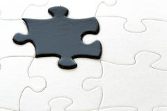 Black and white puzzle pieces Stock Photography