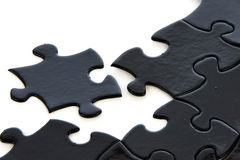 Black and white puzzle pieces Stock Photos