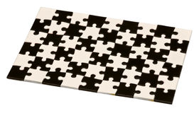 Black and white puzzles. On a white background Royalty Free Stock Photo