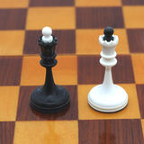 Black and white queen. Chessboard. Black and white queen Stock Images
