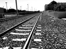 Black and white railroad tracks Stock Photo