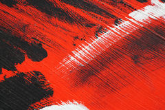 Black, white, red acrylic paint  on metal surface. Brushstroke Stock Photo