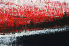 Black, white, red acrylic paint on metal surface. Brushstroke. Stroke of brush with black,white and red acrylic paint on dusty rough metal surface. Textured stock photography