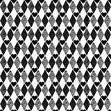 Black seamless background with rhombus and hearts Royalty Free Stock Images