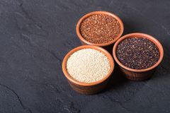Black , white and red quinoa in bowl Stock Photos