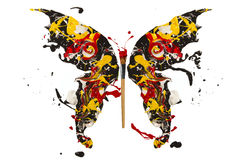 Black white  red yellow paint splash madel butterfly. Black white  red yellow paint splash made conceptual butterfly Royalty Free Stock Photo