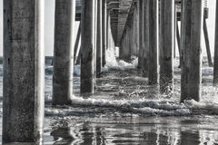 Black and White Reflections under Ocean Pier Stock Image
