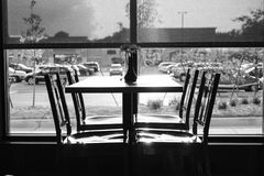 Black and White Restaurant Table and Chairs Royalty Free Stock Photography