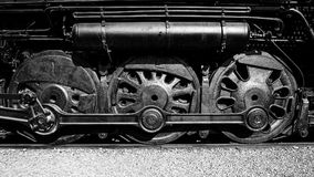 The Three Driving Wheels of a Vintage Steam Locomotive. Black and White retro look of the huge driving wheels  of a vintage steam locomotive from a bygone era Royalty Free Stock Images