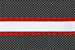 Black and white retro polka dot textile. Background with ribbon Royalty Free Stock Images