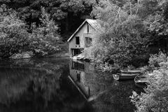 Black and white retro style picture of derelict boathouse and ro Royalty Free Stock Photography