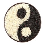 Black and white rice. Forming a yin yang symbol Royalty Free Stock Photos