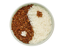 Black and white rice forming a yin yang symbol. Black and white rice forming  yin yang symbol Stock Photography