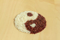Black and white rice forming a yin yang Royalty Free Stock Images