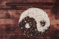 Black and white rice forming a yin yang symbol. Stock Photography