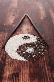 Black and white rice forming a yin yang symbol. Royalty Free Stock Photos