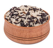 Black and white rice. In a wooden bowl isolated on white background Stock Photos