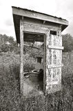 Black and White: Rickety old outhouse Stock Photography
