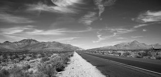 Black and white road. With a semi truck heading to the horizon Royalty Free Stock Photos