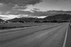 Black and white road and field landscape in the Wasatch Mountains, Utah. Stock Photo