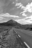 Black and white road to the Errigal mountains Ireland Stock Photos