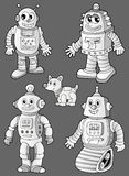 Black and white robots on grey Stock Images