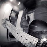 Black and white rock guitar player Stock Image