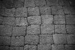 black and white Rock wall background in Phimai Historical Park N Royalty Free Stock Images