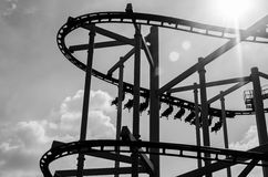 Black and white rollercoaster track in amusement park. Royalty Free Stock Photos