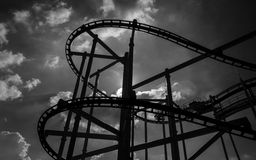 Black and white rollercoaster track in  amusement park. Royalty Free Stock Images