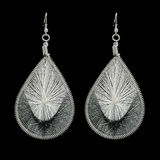Black and white rope braided earrings Royalty Free Stock Photography