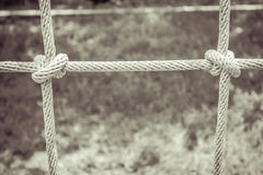 Black and white rope tied into a net for climbing gym at the pla Stock Photos