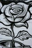 Black and white rose street graffiti detail. Black and white rose street graffiti paint detail wall stock image
