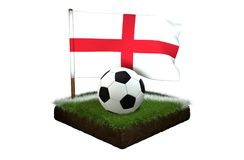 Ball for playing football and national flag of England on field with grass. A black and white round ball for playing football and the national flag of England Stock Photography