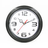 Black and white round wall clock. Isolated on white background Stock Photography