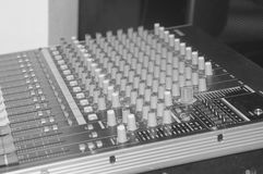 Black and white, routing, and changing the volume level, timbre. Black and white, audio, a mixing console is an electronic device for combining Royalty Free Stock Photography
