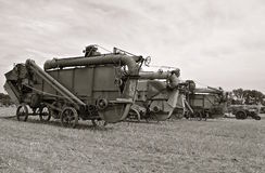 Black and White: Row of old threshing machines (Black and White) Royalty Free Stock Photos
