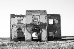 Black and white ruined house in the field Stock Photography