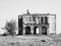 Black and white ruined house in the field Stock Images