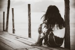 Black and white of Sad and lonely woman sitting alone Stock Photos