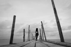 Black and white of Sad and lonely woman stand alone Royalty Free Stock Image