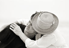 Black White Sad Mother Holding Her Son In Troubled Times Isolated Pale Background Royalty Free Stock Photo