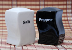 Black and white salt and pepper shakers. Pic Salt and pepper shakers Royalty Free Stock Images