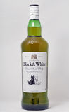 Black and White Scotch Whisky bottle closeup on white Royalty Free Stock Photography